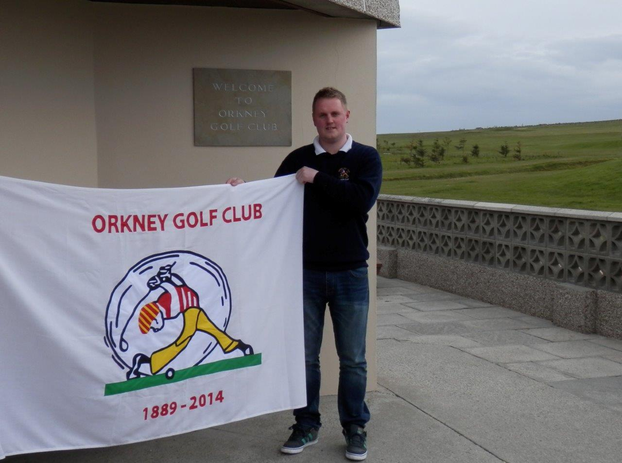 Club Captain, Graham Flett, unfurling the new 125 flag